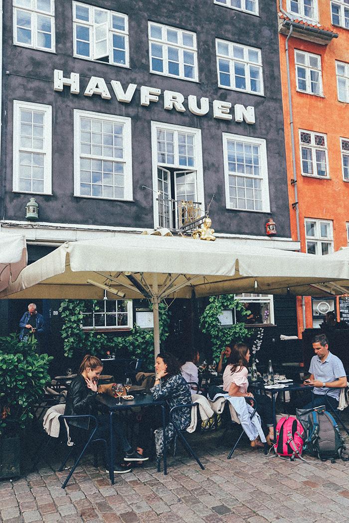 copenhagen havfruen nyhavn people dining