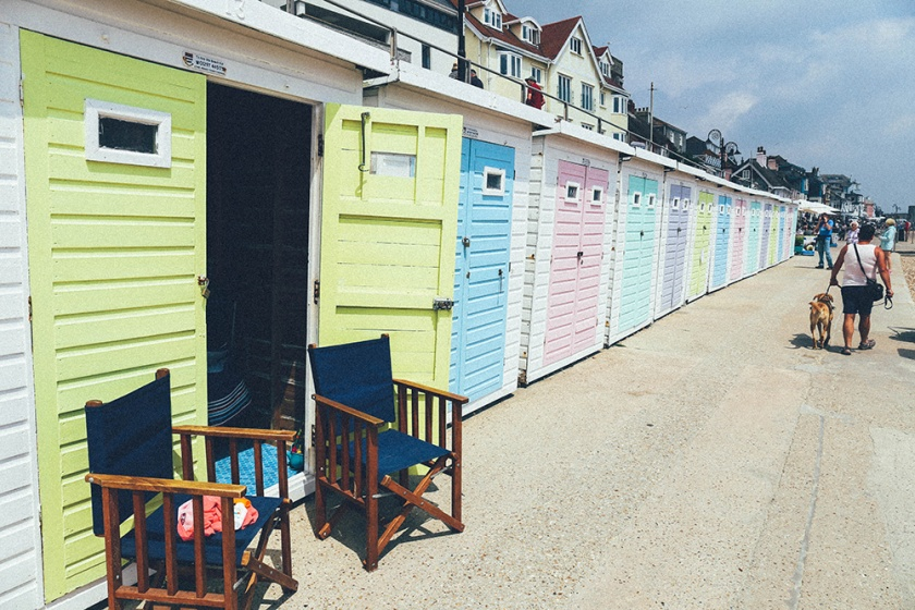 Colourful boat houses Lyme Regis_