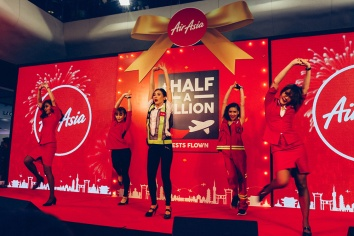 Bangkok thailand airasia half a billion celebration dancers